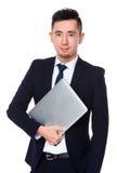 Владение бизнесмена с портативным компьютером Стоковая Фотография