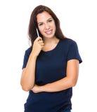Владение женщины с ручкой Стоковые Фотографии RF
