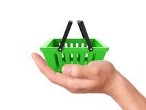 Владение руки магазинная тележкаа Концепция коммерции Стоковое Фото