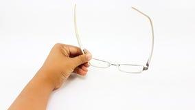 Владение руки человека умные стекла глаза в белых пластичных ноге и bl Стоковые Изображения RF