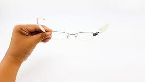 Владение руки человека умные стекла глаза в белых пластичных ноге и bl Стоковое Изображение