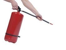 Владение рук на огнетушителе на белой предпосылке Стоковые Фотографии RF