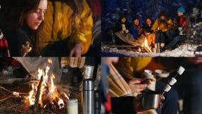 4 в 1 - группа в составе друзья в лесе зимы сидя около костра, есть и имея потеху совместно акции видеоматериалы