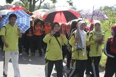 В дне учителей действия зонтика чествуя Стоковые Изображения