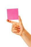 В руке чистый лист красной бумаги Стоковое Фото