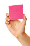 В руке чистый лист красной бумаги Стоковая Фотография RF