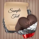 В сердце с очень лентой шоколада foil и заверните лист в бумагу Стоковое Изображение