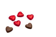 в форме Сердц части шоколада на белой предпосылке Стоковые Фотографии RF