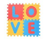 'Влюбленность' написанная с головоломкой алфавита Стоковые Изображения