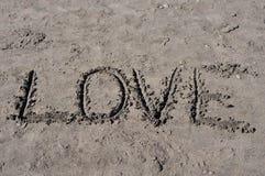 Влюбленность на песке Стоковые Изображения RF