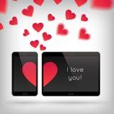 Влюбленность на устройстве Стоковое фото RF