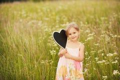 Влюбленность плиты от маленькой девочки Стоковые Фото