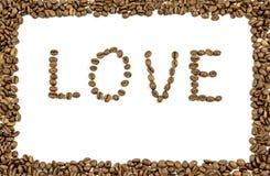 Влюбленность слова написанная с кофейными зернами и рамка сделанная из кофе стоковые изображения rf