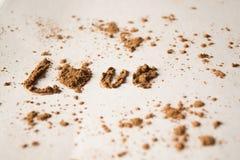 Влюбленность слова от какао, белой предпосылки Стоковое Изображение RF