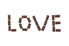 Влюбленность слова сделанная из конфеты шоколада Стоковые Фотографии RF
