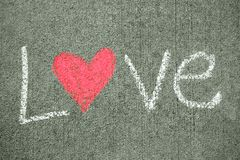 Влюбленность слова с сердцем Стоковое Изображение