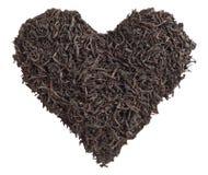 Влюбленность чая Листья чая в форме изолированного сердца Стоковые Фото