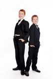 Вoys with red hair in a black suits Royalty Free Stock Images