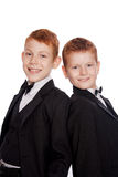 Вoys with red hair in a black suits Royalty Free Stock Photography