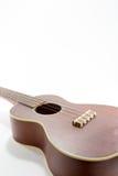 Гавайская гитара Брайна на белизне Стоковое Фото