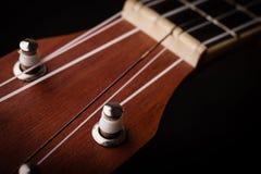 Гавайская гитара на черноте Стоковое Фото