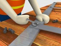 Гаечный ключ удерживания рабочий-строителя затягивает болт Стоковые Изображения RF