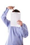 газета r весточки человека надписиeading Стоковая Фотография