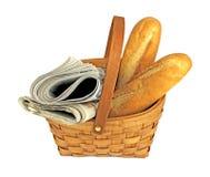 Газеты утра и свежий хлеб в корзине Стоковое фото RF