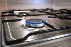 Газовая горелка на цвете стали домашней плиты Стоковые Фото