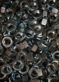 Гайки винта наговора металла закрывают вверх по предпосылке текстуры Стоковые Изображения RF