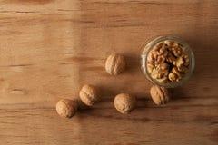 Гайки грецкого ореха на досках Стоковое Изображение RF