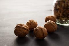 Гайки грецкого ореха на досках Стоковые Изображения RF