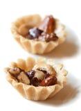 гайки предпосылки изолированные десертами Стоковое Изображение RF