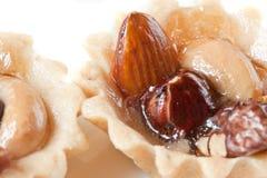 гайки предпосылки изолированные десертами Стоковые Фото