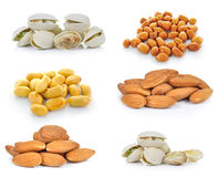Гайки фисташки, миндалины, арахисы на белой предпосылке Стоковые Фото