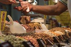Гайки человека покупая Стоковая Фотография RF