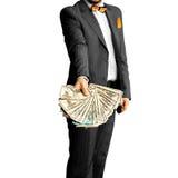 Гай в элегантном костюме с пуком денег в руках Стоковая Фотография RF