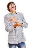 Гай смеясь над с телефоном Стоковое фото RF