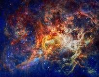 Галактика и межзвёздные облака в космическом пространстве Элементы этого изображения поставленные NASA стоковое фото