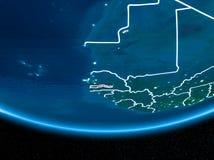 Гамбия на земле планеты от космоса на ноче Стоковые Фотографии RF