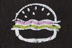 Гамбургер и cheeseburger, абстрактная картина на черной предпосылке Стоковые Изображения