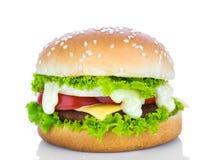 гамбургер предпосылки близкий снятый вверх по белизне Стоковое фото RF