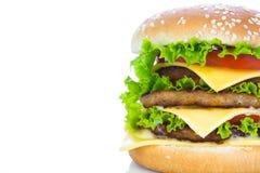 гамбургер предпосылки близкий снятый вверх по белизне Стоковые Фотографии RF