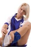 гандбол имея его игрока боли ноги Стоковые Изображения