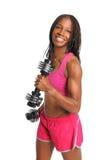 Гантели молодой женщины завивая Стоковая Фотография RF