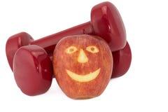 Гантели и яблоко Стоковое фото RF