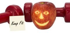 Гантели и яблоко Стоковое Изображение
