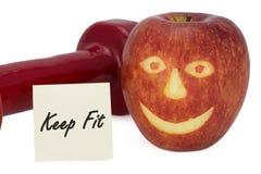 Гантели и яблоко Стоковые Фотографии RF