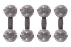 4 гантели поднятия тяжестей изолированной на белизне Стоковые Изображения
