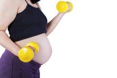 гантели работая беременную женщину Стоковое фото RF